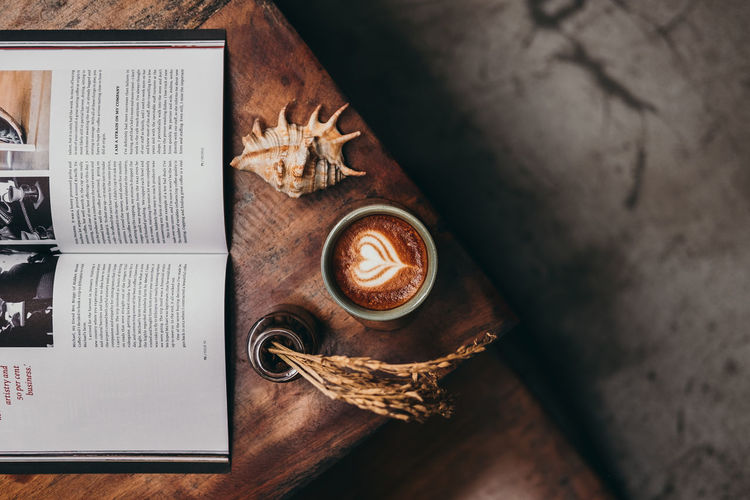 for me book is the window of the heart, and coffee is the heart itself 17.62° Coffee Cappuccino Flat Lay Coffee - Drink Coffee Cup Latte Latte Art Directly Above Close-up Froth Art