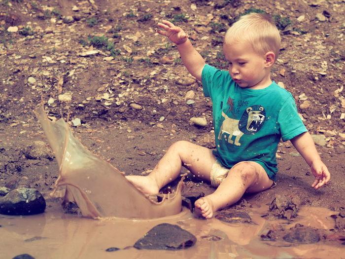 Mud Mudpie Child Childhood Full Length Sand Pail And Shovel Boys Males  Blond Hair Playing Sitting Sand Preschooler Muddy Puddle Rainy Season