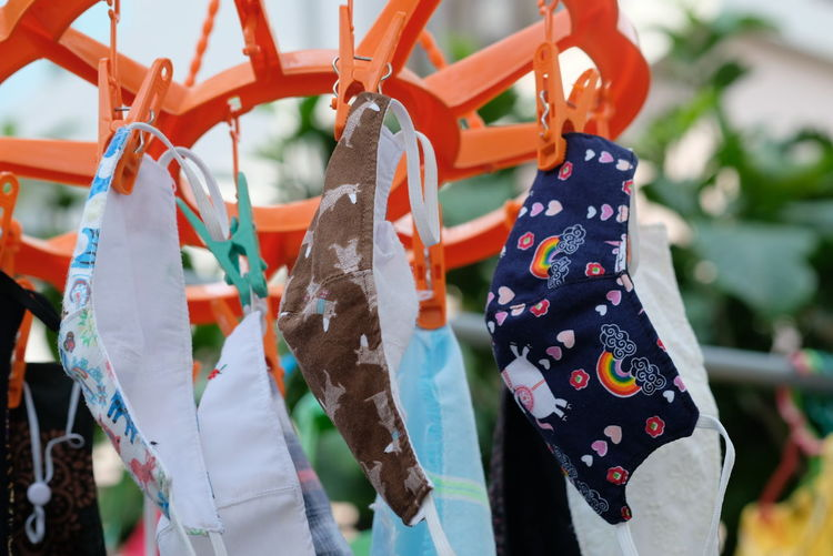 Close-up of multi colored clothespins hanging on clothesline