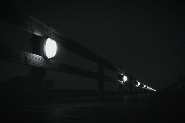 Marshwalk Night Nightphotography Blackandwhite Guidetheway Followthelight Eery