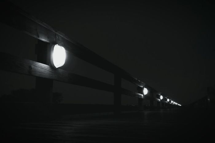 Marshwalk Night Nightphotography Blackandwhite Guidetheway Followthelight Eery