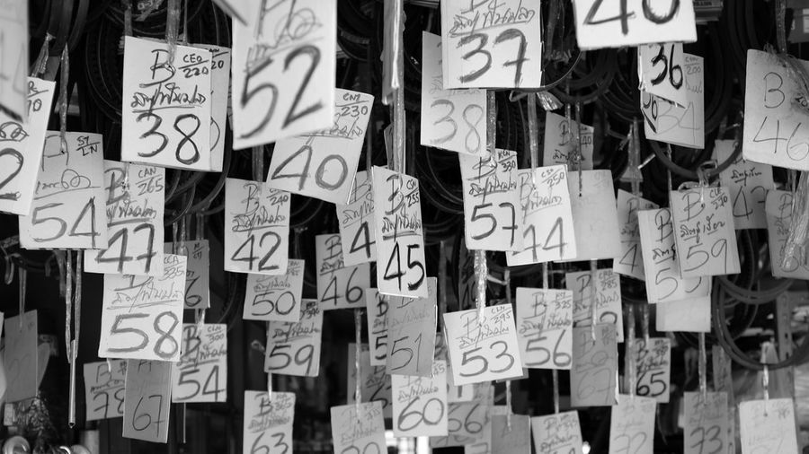 B&w Street Photography Black And White Blackandwhite Numbers Pattern Pieces Phuket Price Shop Sign Street Photography Thailand Spotted In Thailand