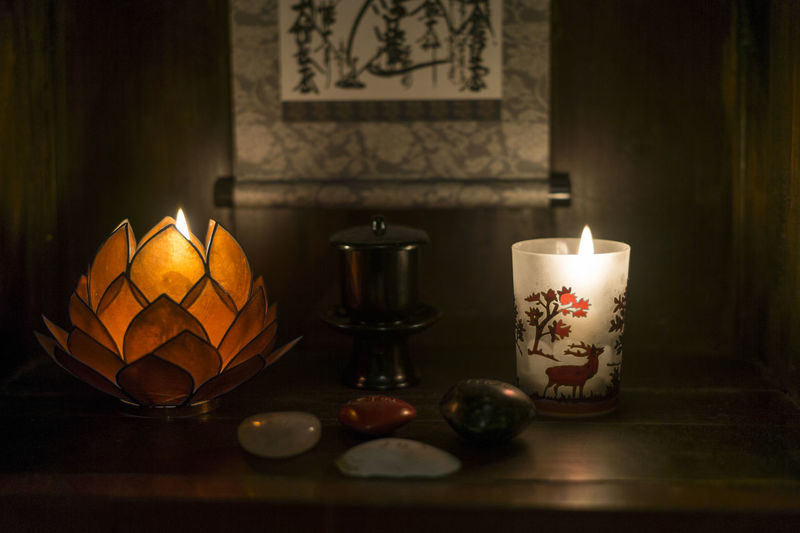 Zen Buddhism Burning Candle Close-up Flame Heat - Temperature Home Interior Illuminated Indoors  Japanese  Lantern Night No People Oil Lamp Table Tea Light