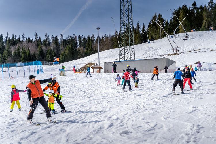 Group of people enjoying on snow