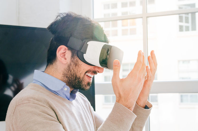 The Future is now. Nostock Only Men One Man Only Window Beard Business One Person Business Finance And Industry Adults Only Men Indoors  Businessman Headshot Businesswear Adult Office People Day Working Technology Innovation Vr Virtual Reality Candid Portraits Break The Mold
