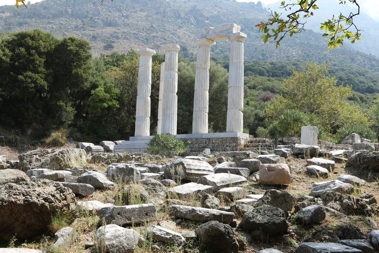 View of Sanctuary of the Great Gods in Samothrace, Aegean Islands, East Macedonia and Thrace. Greece. Aegean Islands Ancient Ancient Civilization Ancient Ruins Architectural Column Architecture Day Greece History Landscape Mountain Nature No People Old Ruin Outdoors Rock - Object Samothrace Sky Travel Destinations Tree