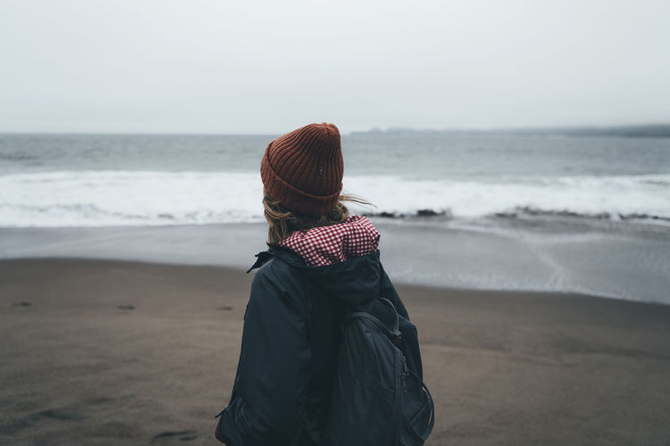Mid adult woman standing at beach