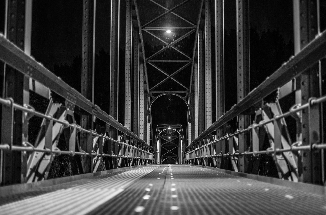 built structure, architecture, the way forward, direction, connection, bridge, bridge - man made structure, diminishing perspective, transportation, vanishing point, no people, metal, road, arch, railing, illuminated, night, symbol, indoors, surface level, long