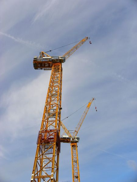 Crane - Construction Machinery Construction Site Day Outdoors No People Architecture Construction Construction Equipment Crane Boom Industry Sky Yellow Crane Yellow Crane Tower Two Cranes Tower Cranes High High Crane