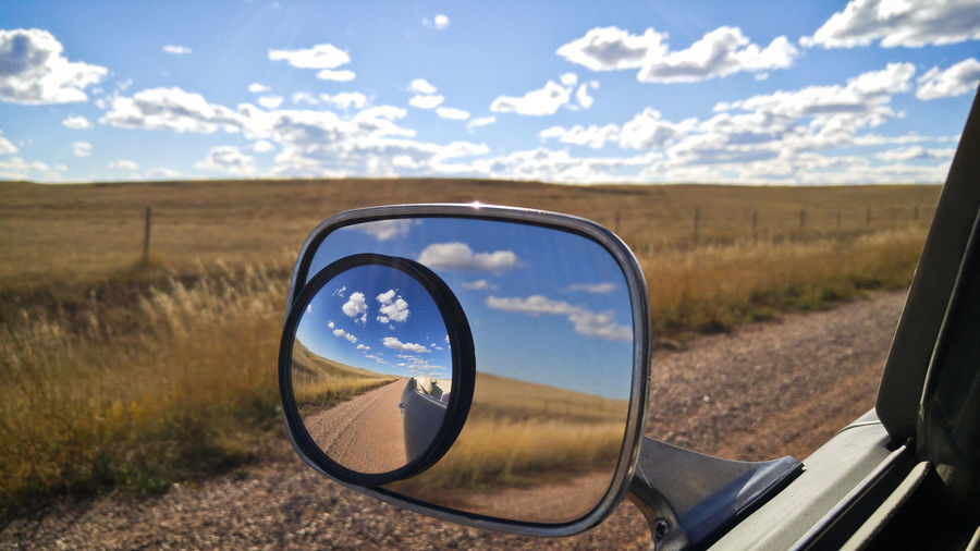 Side-view Mirror Car Reflection Rural Scene Travel Cloud - Sky Landscape Land Sky Mirror Driving Exploring Plains Prairie Wyoming Wide Open Spaces Big Sky Clouds Grass Grassland Scenics - Nature Transportation Vehicle Mirror Environment Sunshine