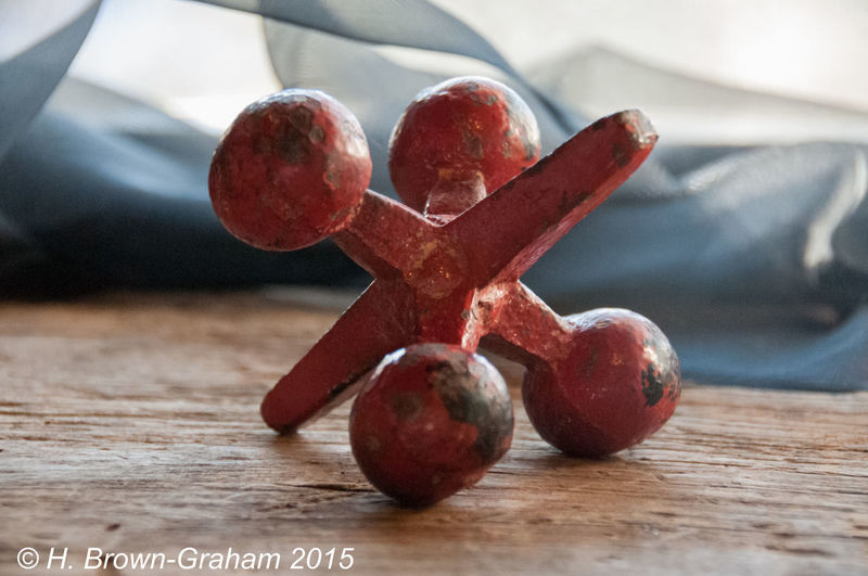 Close-up Focus On Foreground Jacks Red Still Life Wood Grain