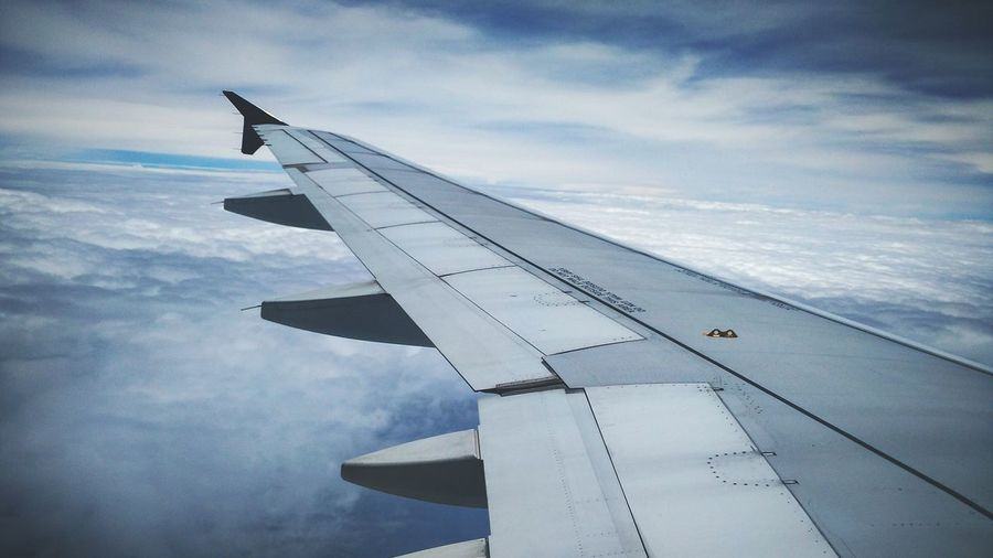 Airplane wing against sky