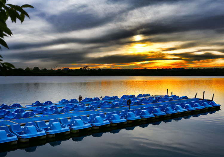 At rest Docked Moored Boats Paddle Boats Potomac River Beauty In Nature Boats Cloud - Sky Day Docked Boats In A Row Nature No People Outdoors Scenics Sky Sunset Tranquility Water
