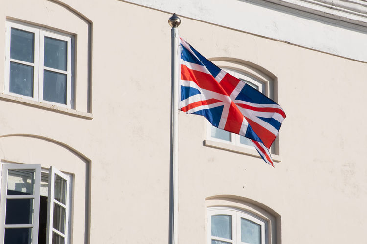 Union Flag Flying in Front of building Building Exterior Architecture Patriotism Flag Building Union Flag Union Jack National Icon Uk Pride Symbol