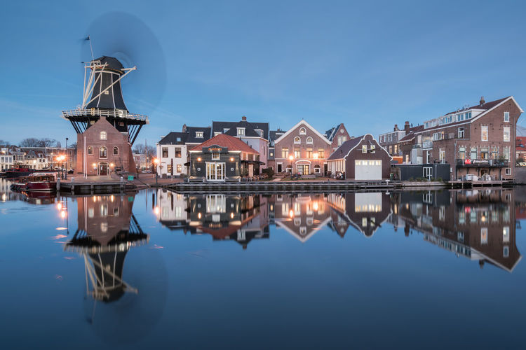 Working overtime Adriaan Architecture Blue Hour City Cityscape Dusk Dutch Europe Haarlem Holland Illuminated Long Exposure Nederland Netherlands No People Old Buildings Outdoors Reflection River Riverside Spaarne Travel Destinations Urban Skyline Water Windmill