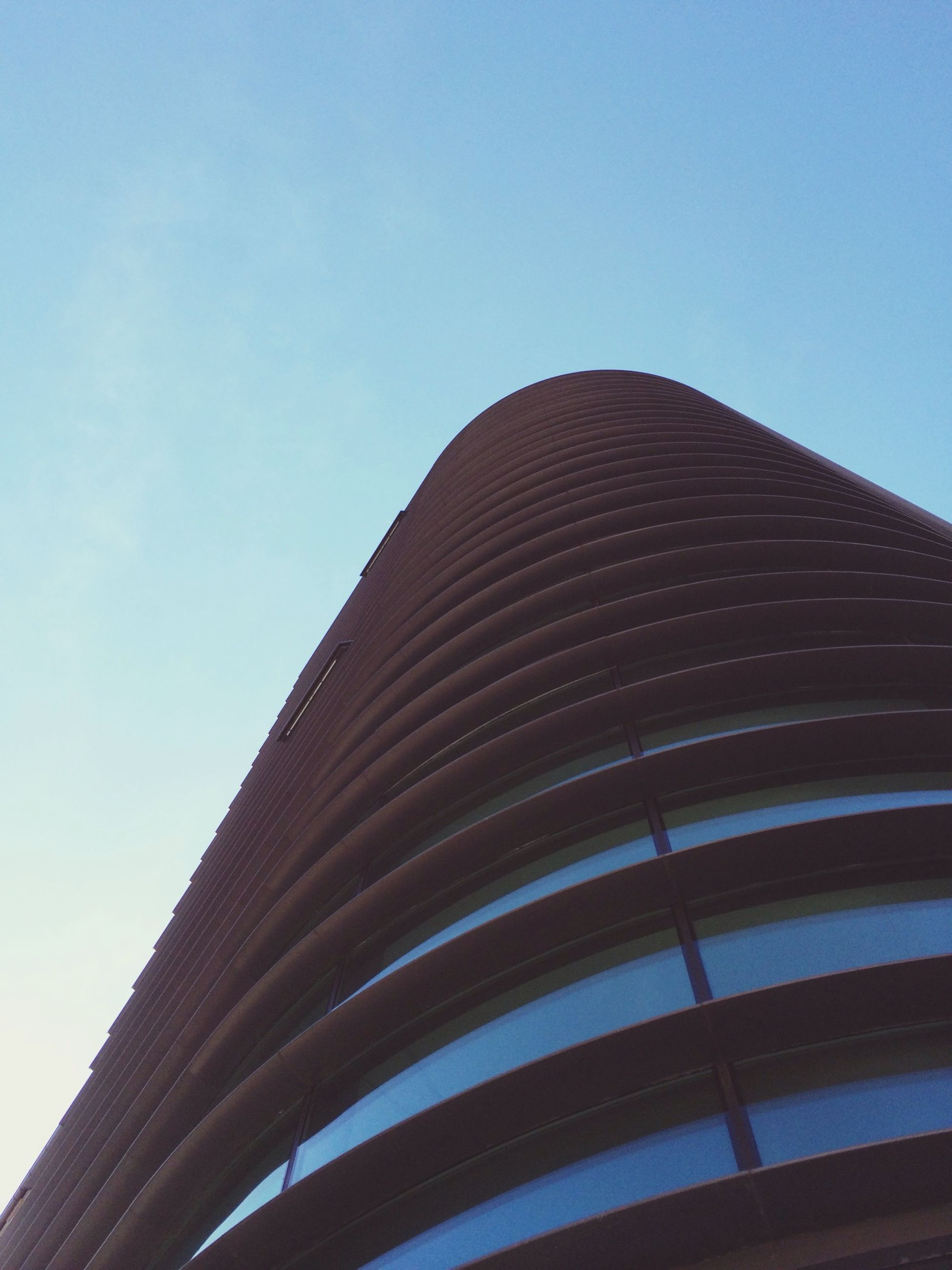 architecture, low angle view, built structure, building exterior, clear sky, modern, tall - high, office building, city, blue, building, tower, skyscraper, sky, pattern, copy space, day, no people, outdoors, architectural feature