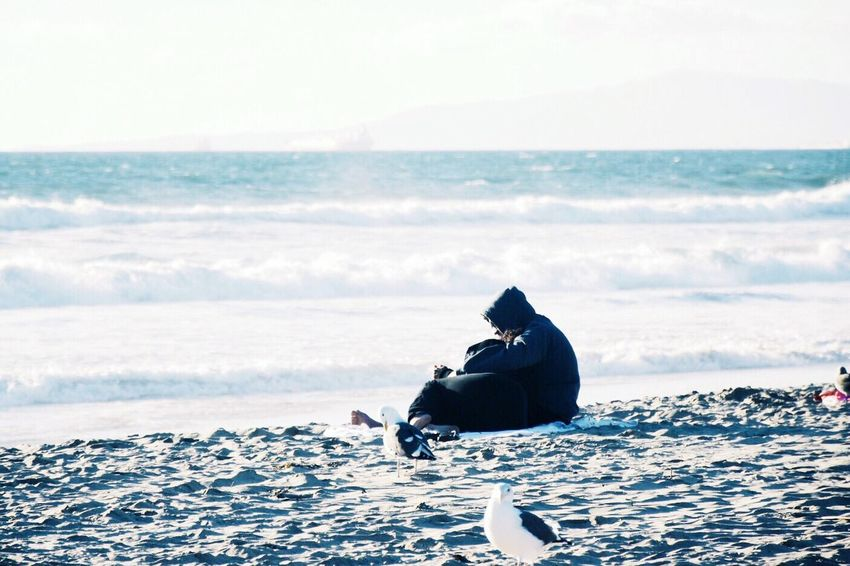 Setting fires keep you warm. Sea Cold Temperature One Person One Man Only Only Men Sitting Nature People Adult Warm Clothing Outdoors Adults Only Sky Men Beauty In Nature Day Who What Where Seascape Seaside Beach Photography