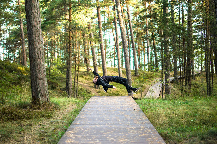 Man falling on footpath in a forest