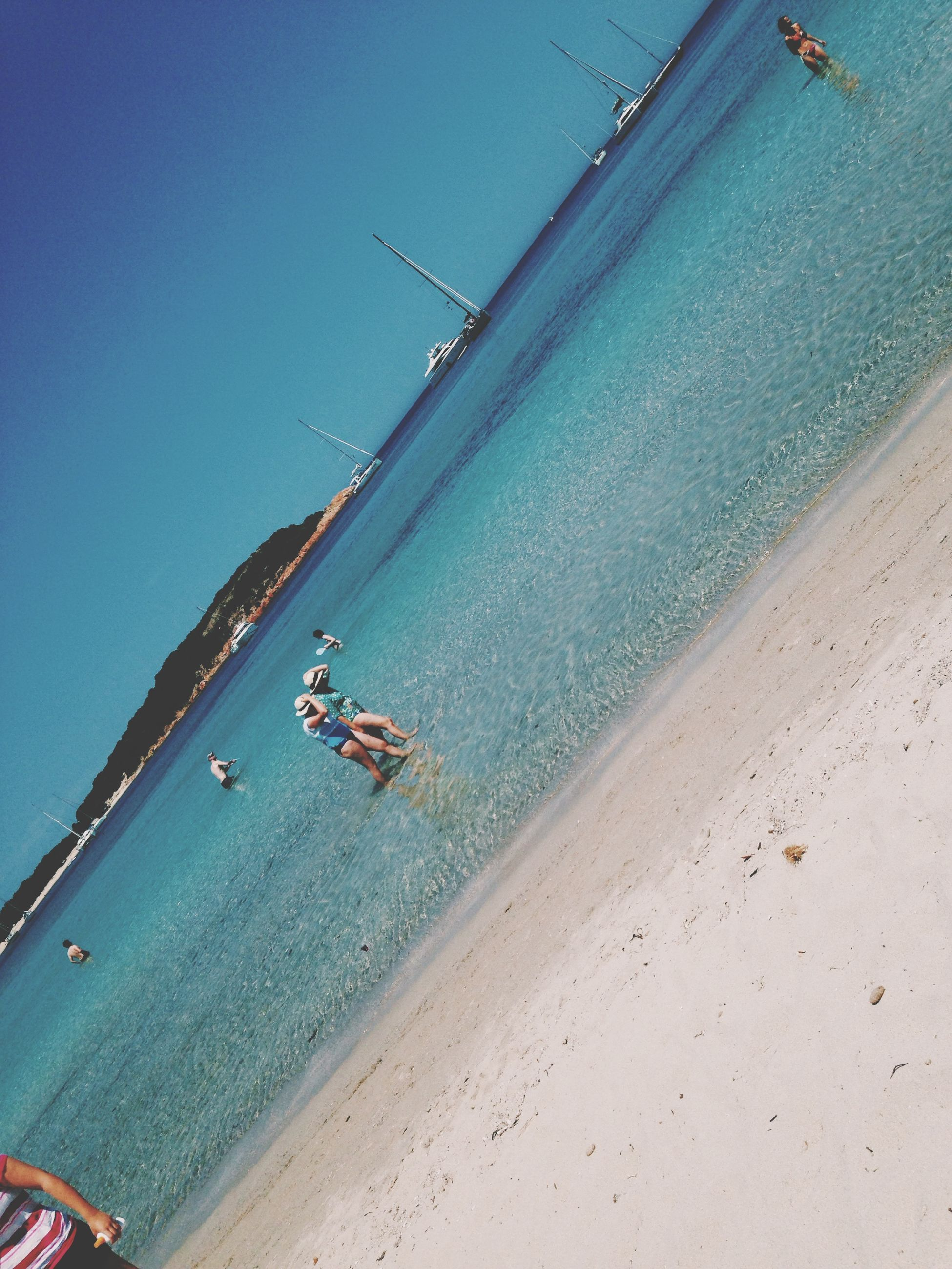 sea, water, beach, leisure activity, lifestyles, transportation, nautical vessel, men, sand, vacations, mode of transport, shore, enjoyment, high angle view, travel, large group of people, fun, blue, boat