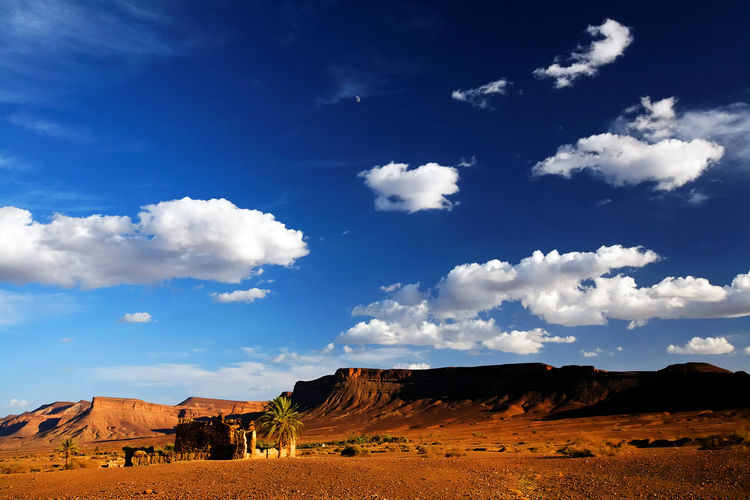 Distant View Of Atlas Mountain At Erg Chebbi Against Sky