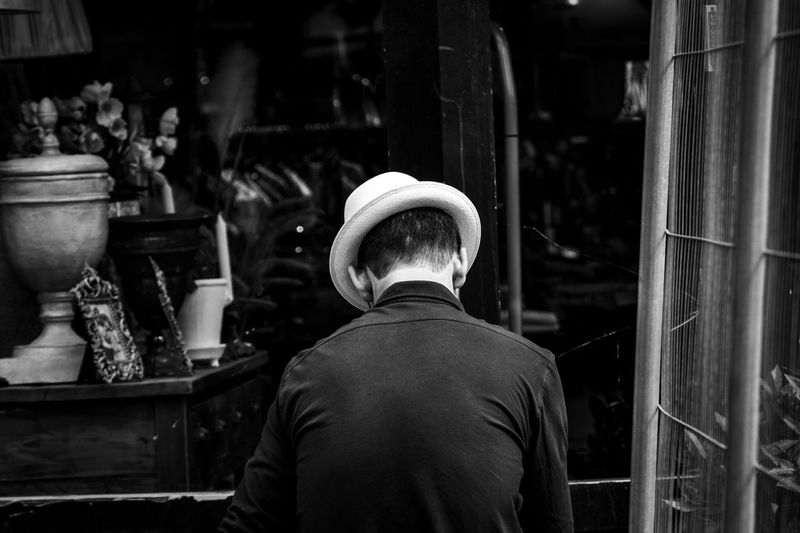 Rear view of man working at market stall