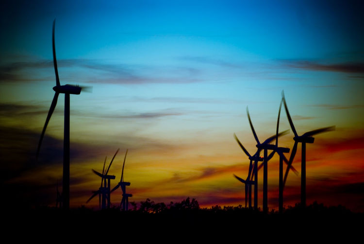 Wind farm at dusk Alternative Energy Beauty In Nature Cloud - Sky Day Environmental Conservation Fuel And Power Generation Industrial Windmill Landscape Nature No People Outdoors Renewable Energy Rural Scene Scenics Silhouette Sky Sunset Technology Tranquil Scene Tranquility Wind Power Wind Turbine Windmill