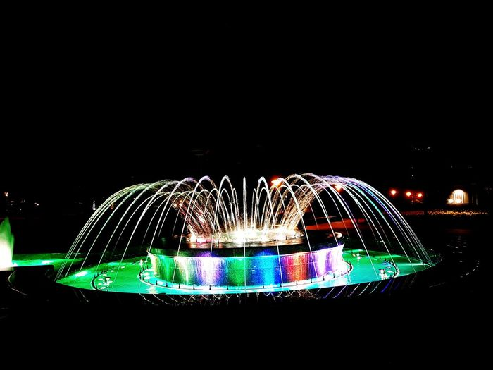 Fountain Fountain Show Illuminated Water Multi Colored Motion Arts Culture And Entertainment Amusement Park Long Exposure Amusement Park Ride Abstract Sky