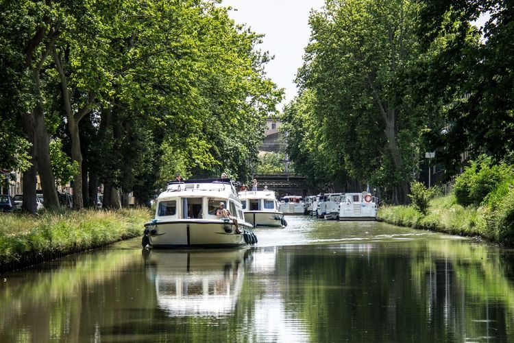 Peace And Quiet Canals And Waterways Day Green Color Mode Of Transportation Nature Nautical Vessel Outdoors Plant Reflection River Tranquil Scene Transportation Travel Tree Water