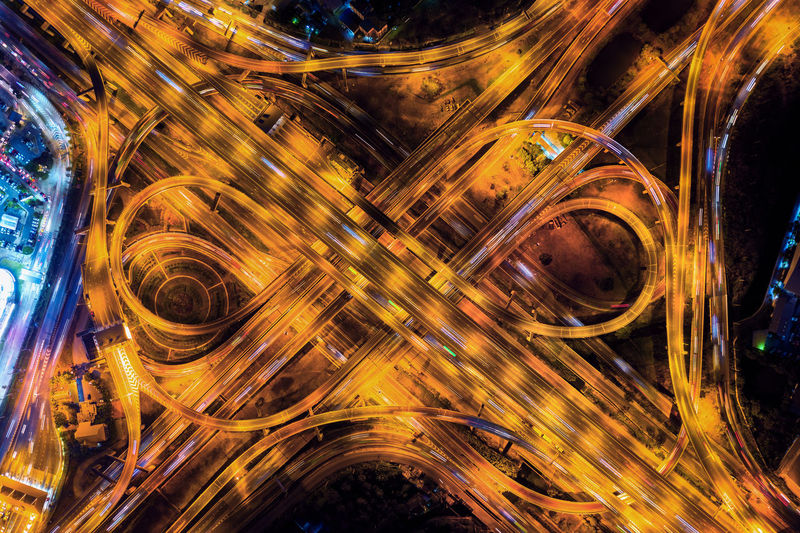 Aerial view of traffic on massive highway intersection at night. Illuminated Motion Night Long Exposure No People Architecture Light Trail Blurred Motion