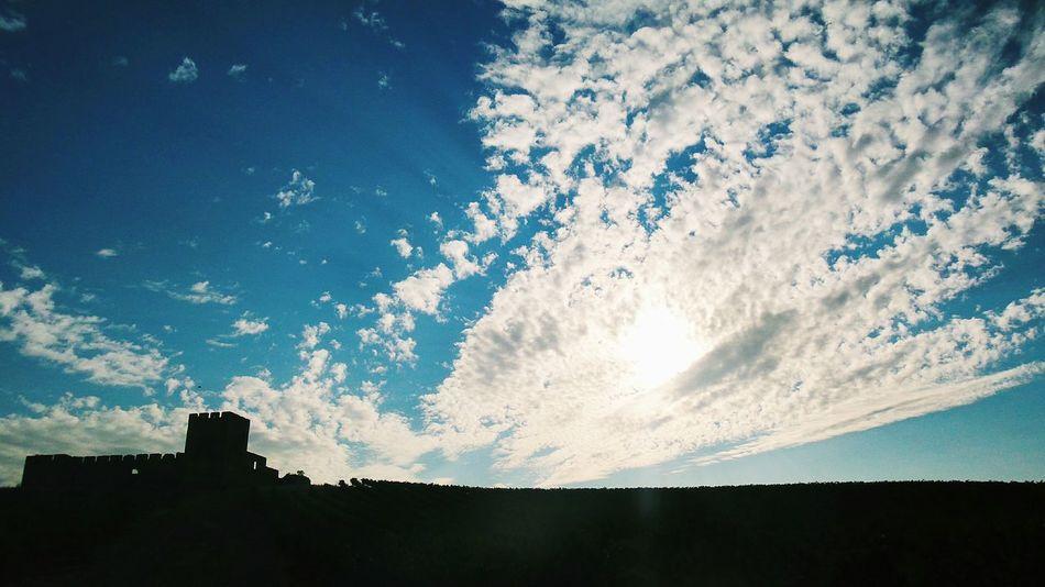 Silhouette of old castle. Alentejo Portugal Silhouette dusk Clouds Old Monument Valongo castle Walls sunset