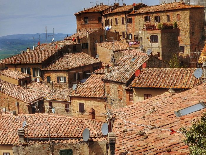 Roofs of Volterra, Italy Building Exterior Architecture Building Built Structure Roof Residential District City House Roof Tile Town No People Day High Angle View Old Outdoors Sunlight TOWNSCAPE