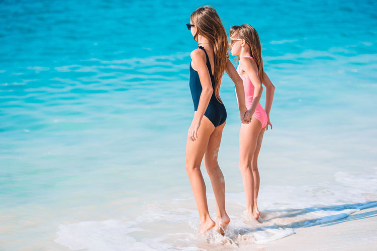 Rear view of women at beach