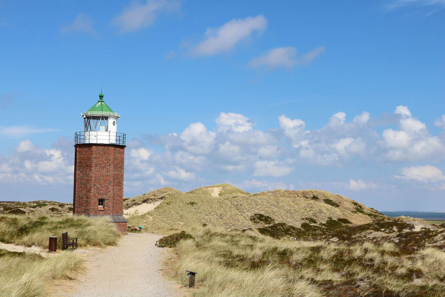 Landscape of Rotes Kliff lighthouse, on the island of Sylt, Germany, located on a cliffside north of the village of Kampen. Dunes German Heath Hiking Kampen Path Scenic Architecture Building Day Dunescape Erica Germany Island Landscape Lighthouse No People Northsea Outdoors Scenics - Nature Sky Summer Sylt Tourism Way