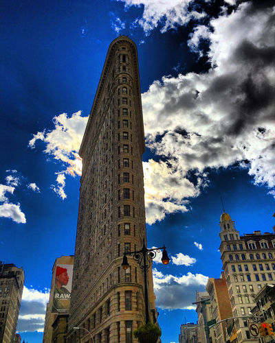 Flatiron Building Architecture Building Exterior Built Structure City City Life Cloud - Sky Clouds Day Flatiron Building Flatironbuildingnyc No People Outdoors Sky Skyscraper Sunlight Tower Travel Destinations Urban Skyline