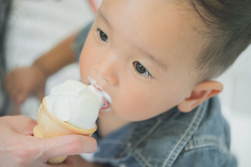 Close-up portrait of cute baby eating food