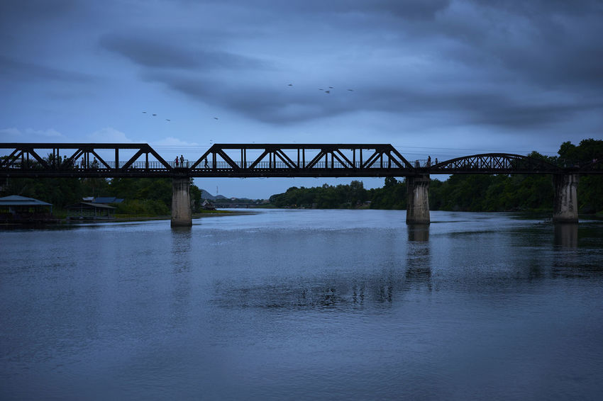 Moody evenning shot from the River overlooking the River Kwai Bridge Atmospheric Mood Bridge Bridge - Man Made Structure Bridge Over The River Kwai Built Structure Cloud - Sky Cloudy Connection Engineering Kanchanburi Railway Bridge River River Kwai Silouette Thailand Transportation Water