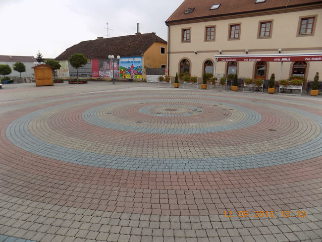 Centrum Mundi Architecture Building Exterior Built Structure City City Life Cobbled Cobblestone Day Footpath Fountain House In Front Of Local Landmark Outdoors Paving Stone Residential Building Sky Surface Level The Way Forward Town Square Travel Destinations