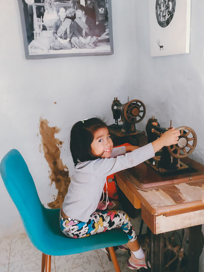 Cute girl playing with toy at home