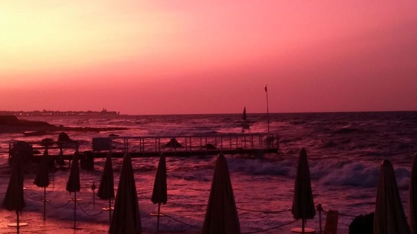 Sunset Sea Pink Color Horizon Over Water Beach Red Purple No People Water Outdoors Travel Destinations Nautical Vessel Sky Scenics Vacations Night Beauty In Nature