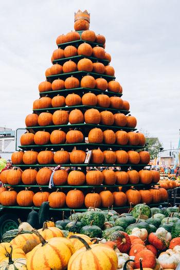 Stack of pumpkins for sale in market