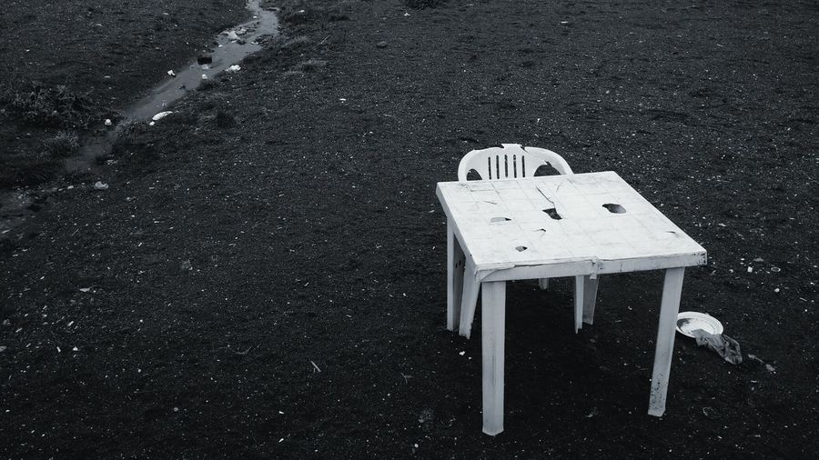 B&w Photography Showcase: January Chair Table Plate Broken Forgotten Abandoned Alone At The Port Telling Stories Differently