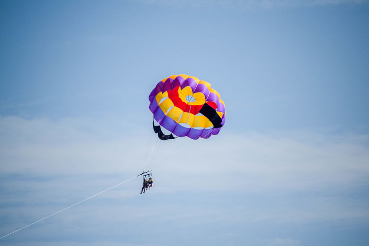 Sky Extreme Sports Sport Parachute Adventure Mid-air Paragliding Leisure Activity Real People Transportation Freedom Low Angle View Multi Colored Parasailing Nature Clear Sky Blue Copy Space