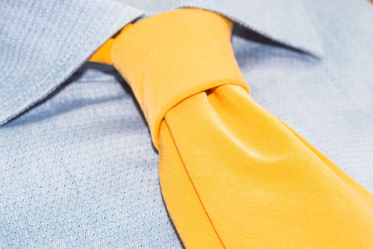 Close-up of yellow tie