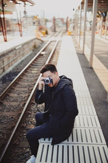 Young man on railroad station