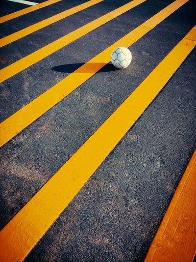 High Angle View Of Ball On Road