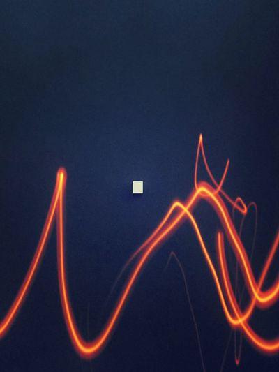 Close-up of illuminated light painting at night