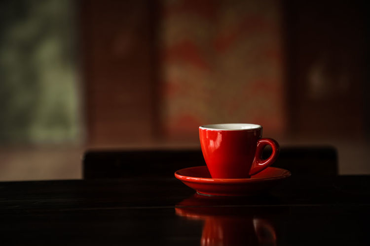 Coffee in cup on table