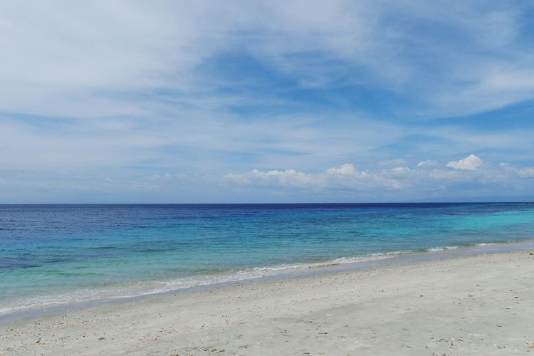 Sea Beach Sand Blue Water Horizon Over Water Sky Outdoors Tranquility Cloud - Sky Tranquil Scene Idyllic Beauty In Nature Scenics Travel Destinations Nature Horizontal Coastline No People Landscape Finding New Frontiers