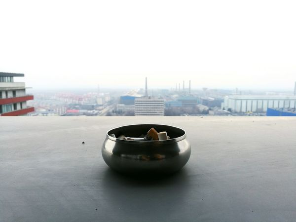 No People Outdoors Day Close-up Backgrounds Sky Residential Building Building Exterior Finding New Frontiers City View  Cityscape City Business Life City Life Building City Skyline Tranquil Scene Cigarette  Smoke Smoking