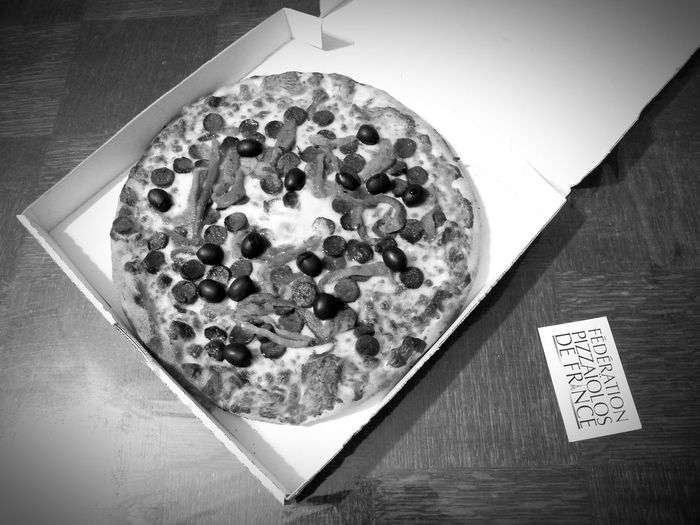 Full size serving pizza Oriental Pizza Food Black Olives Pizza Bnw White Pizza Box Delivery On Table Card Horizontal Photography Food Photography Ready To Heat Ready-to-eat Black And White Light From Bottom Left Corner Bnw1 Filter PizzaOfEyeEm In France